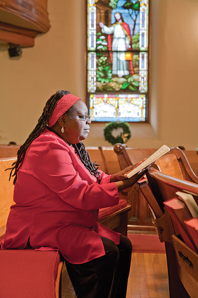 Woman in church pew